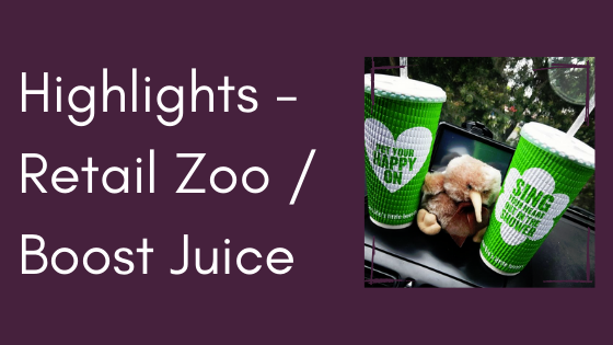 Text: Highlights - Retail Zoo / Boost Juice Image: Two Boost Juice cups sitting on a car dash with a soft toy between them.