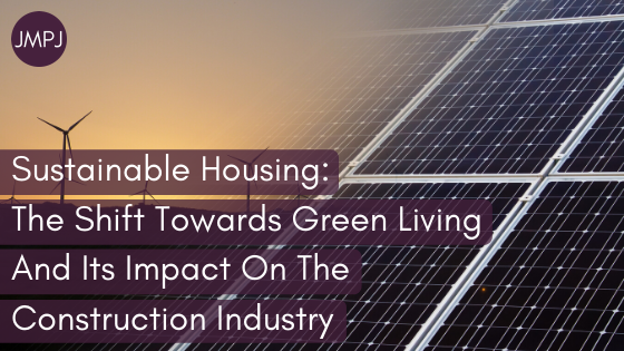 "Blog Banner: The words ""ustainable Housing_ The Shift Towards Green Living And Its Impact On The Construction Industry"" overload on an image of solar panels and wind turbines."